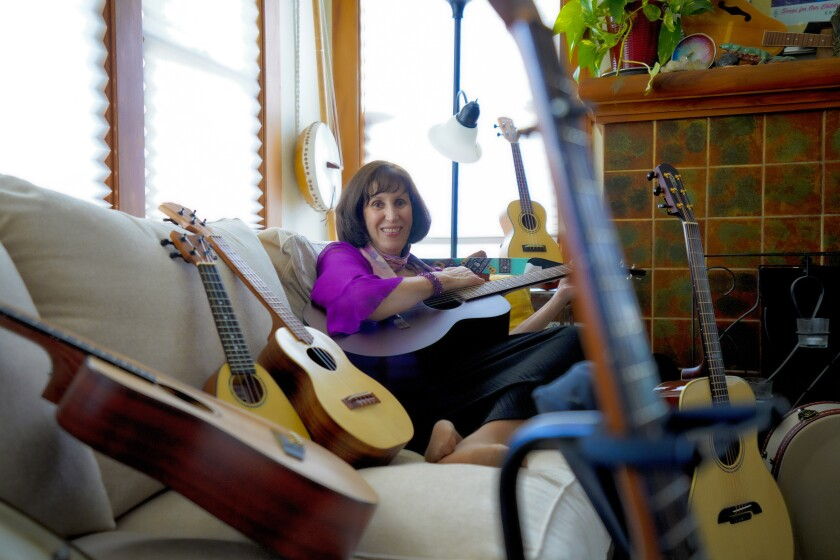 Guitars and Ukes in the Classroom founder Jess Baron in her North Park home.