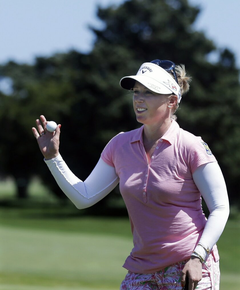 Morgan Pressel shows her ball after a birdie of the third hole of the second round of the ShopRite LPGA Classic golf tournament, Saturday, May 30, 2015, in Galloway Township, N.J. (AP Photo/Mel Evans)