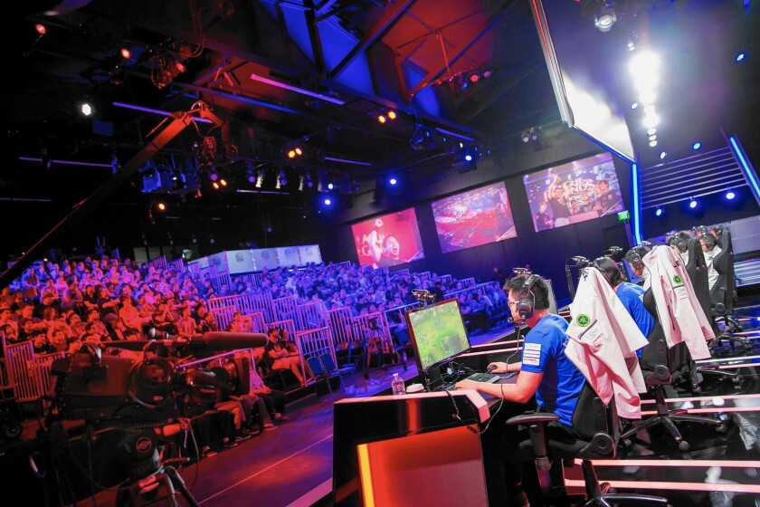 ESports programming on TBS in 2016 is set to feature a pair of 10-week seasons. Above, a video gaming competition at the Riot Games studio in L.A.