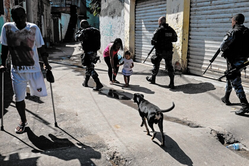 Police patrol a shantytown in Rio de Janeiro. The number of killings in Brazil has dropped in larger, more affluent cities such as Rio but jumped in poorer areas.