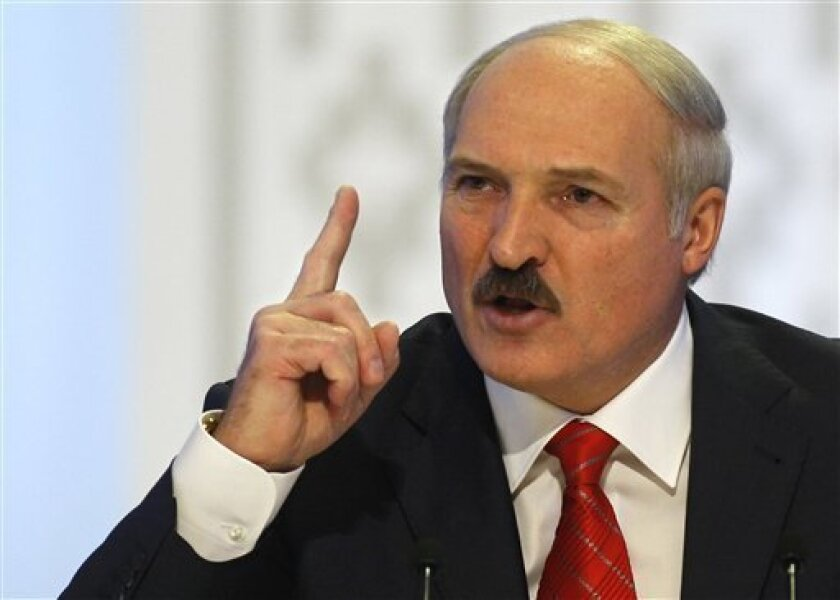 In this Dec. 20, 2010 photo, Belarusian President Alexander Lukashenko gestures prior to a news conference in the capital, Minsk. Belarus' authoritarian government further tightened its control over citizens' access to Internet on Friday Jan. 6, 2012 with a new law that obliges service providers to monitor users. (AP Photo/Sergei Grits)