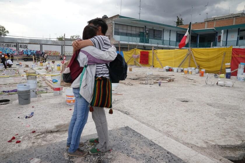 Giselle Mejia, 23, and David Montoya, 32, students at National Autonomous University of Mexico, hug