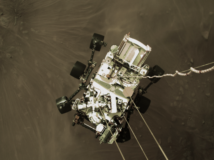 NASA's Perseverance rover descends to the surface of Mars during the skycrane maneuver.