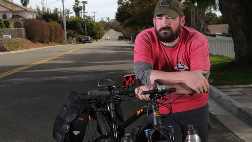 Eli Smith, photographed in Oceanside Monday, is finishing an across country trip to benefit veterans