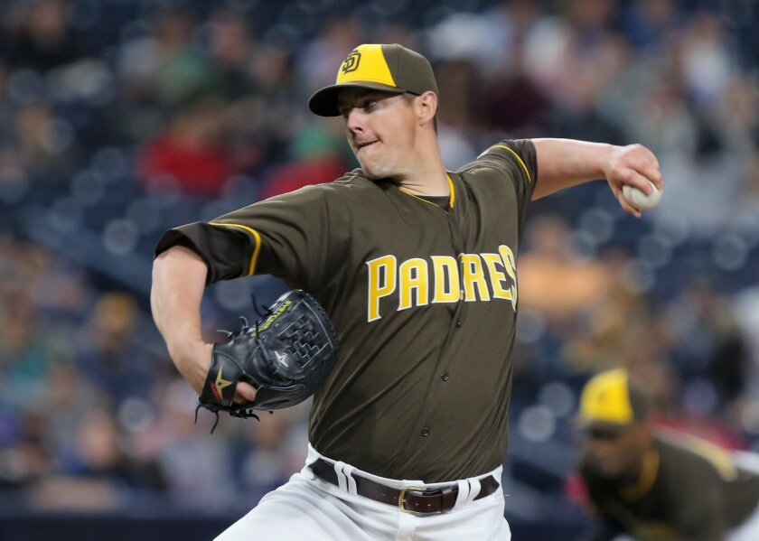 Padres' left handed reliever Ryan Buchter fires to the plate.