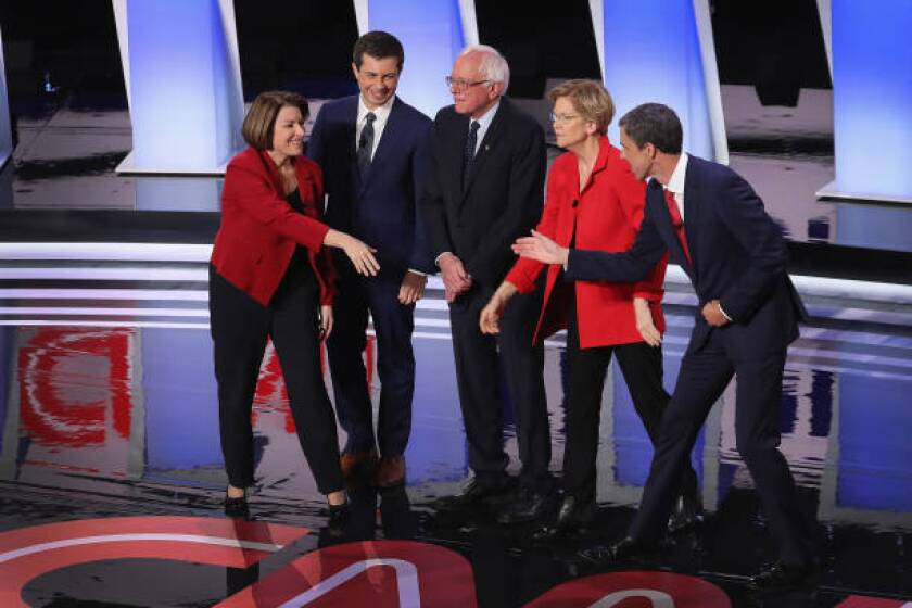 Democratic presidential candidates Sen. Amy Klobuchar, left, South Bend Mayor Pete Buttigieg, Sen. Bernie Sanders, Sen. Elizabeth Warren and former Texas Rep. Beto O'Rourke take the stage Tuesday night at Detroit's Fox Theatre.