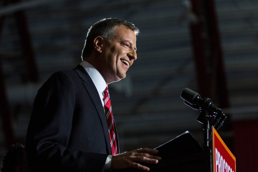 Newly elected Mayor Bill de Blasio speaks at his election night party in New York City.