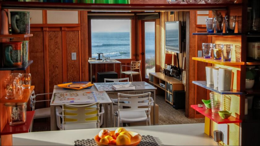 The kitchen provides a view of the dining room and ocean.