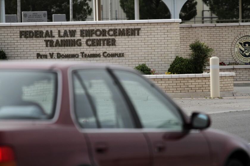 A car enters the Federal Law Enforcement Training Center in Artesia, N.M., which is serving as a detention facility for adult immigrants who entered the country illegally accompanied by children.