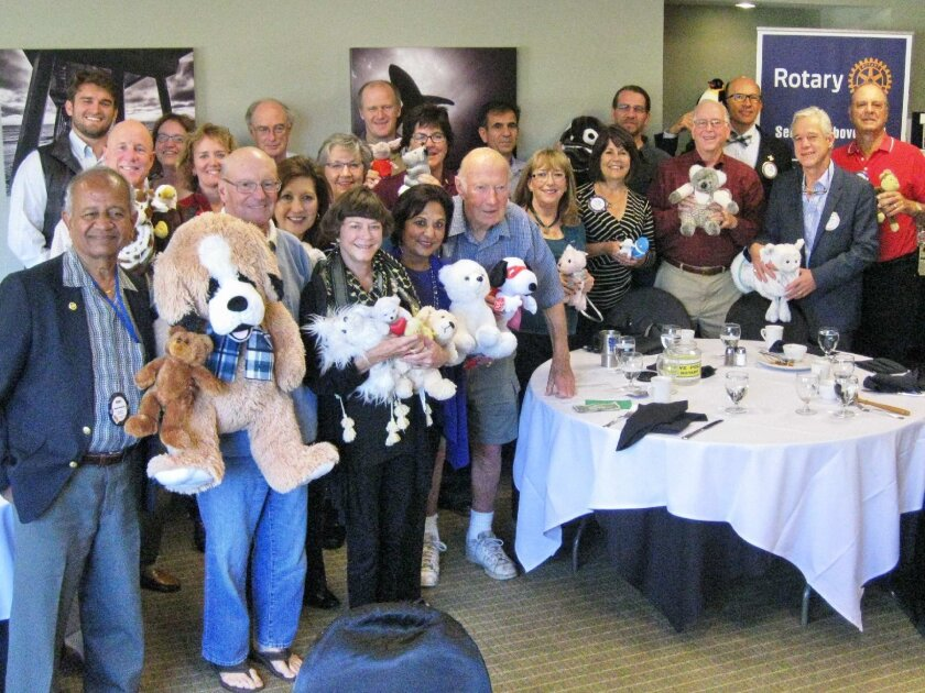 At a recent meeting of the Del Mar-Solana Beach Rotary Club, members collected and donated more than three dozen stuffed animals — plus cash donations — to Voices for Children so that it could provide holiday gifts to foster children this season.