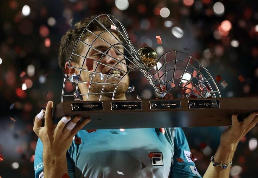 Argentina's Diego Schwartzman celebrates after winning the Rio Open on Feb. 25, 2018, in Rio de Janeiro, Brazil. EPA-EFE FILE/Marcelo Sayão