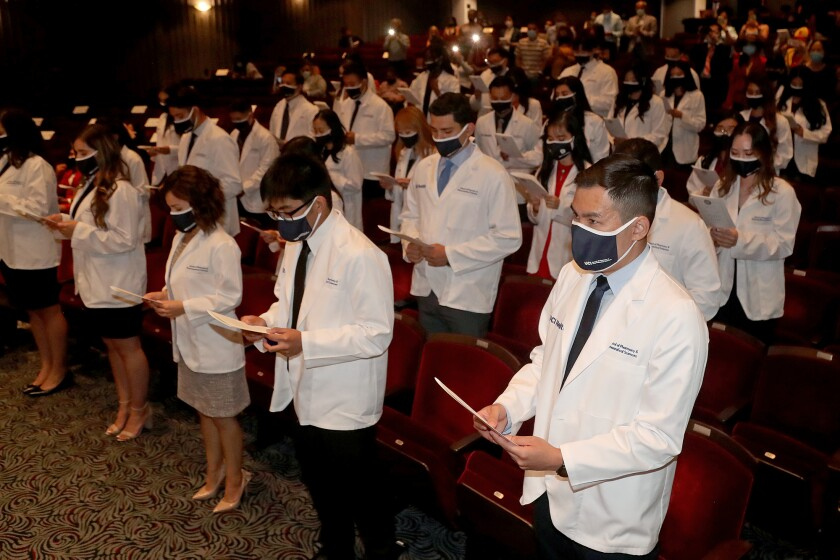 Students recite the Oath of a Pharmacist during the White Coat Ceremony at the Irvine Barclay Theater.