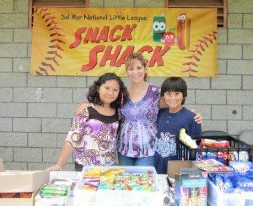 DMLL Snack Shack volunteers Melanie,  Gloria and Danny Limas An