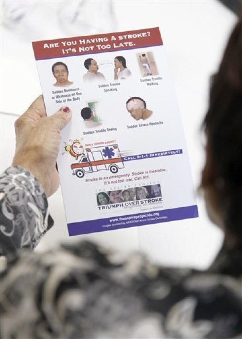 A senior reads over a refrigerator magnet with information on the signs of having a stroke and what steps they should take, during a community meeting at Hattie Holmes Wellness Center in the Petworth neighborhood of Washington, Monday, Oct. 4, 2010.(AP Photo/Pablo Martinez Monsivais)