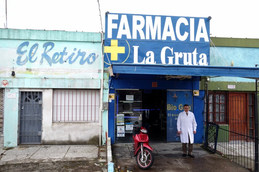 Jorge Suarez, president of Uruguay's Pharmacy Assn., stands in front of his Montevideo pharmacy, from which he will soon be selling small amounts of marijuana to registered users.