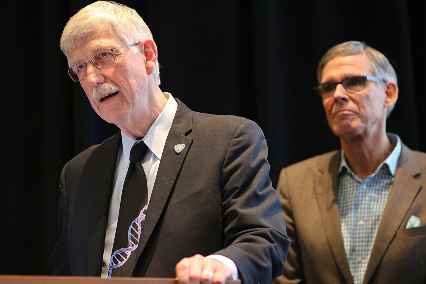NIH director Francis Collins talks at the 2015 Future of Genomic Medicine Conference. In the background is Scripps Health cardiologist/geneticist Dr. Eric Topol.