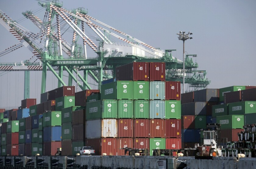In November, California businesses shipped merchandise worth $15.2 billion, a 14% jump over the same month in 2012, new government statistics show. Above, containers sit on a dock at the Port of Los Angeles.