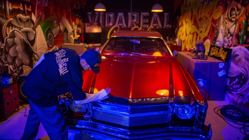 Jose Americo Crippa polishes his car during a gathering of lowrider enthusiasts in Sao Paulo, Brazil.