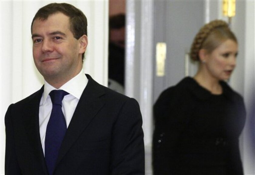 Russian President Dmitry Medvedev, left, and Ukrainian Prime Minister Yulia Tymoshenko, right, are seen during a meeting on the European gas crisis in Moscow, Saturday, Jan. 17, 2009. Ukrainian, Russian and European officials held talks in Moscow on Saturday in an effort to restore Russian natural