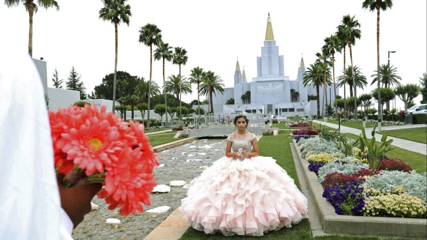 In this Saturday, June 15, 2019 photo, quinceañera Joseline Garcia, of Oakley, poses during a photo