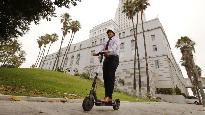 Los Angeles City Councilman Joe Buscaino rides a Bird rental scooter around City Hall on Sept. 4.
