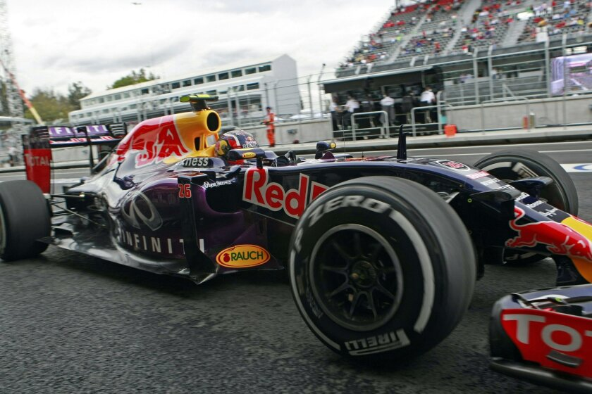 Red Bull driver Daniil Kvyat of Russia arrives at his team's pit during the third practice session for the Formula One Mexico Grand Prix auto race at the Hermanos Rodriguez racetrack in Mexico City, Saturday, Oct. 31, 2015. (AP Photo/Christian Palma)