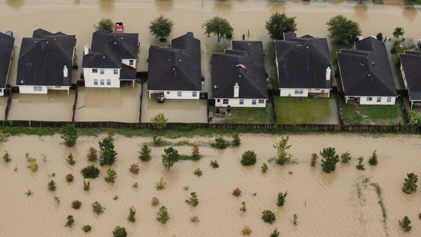 Residential neighborhoods near Interstate 10 in Houston sit in floodwater in the wake of Hurricane Harvey in August.