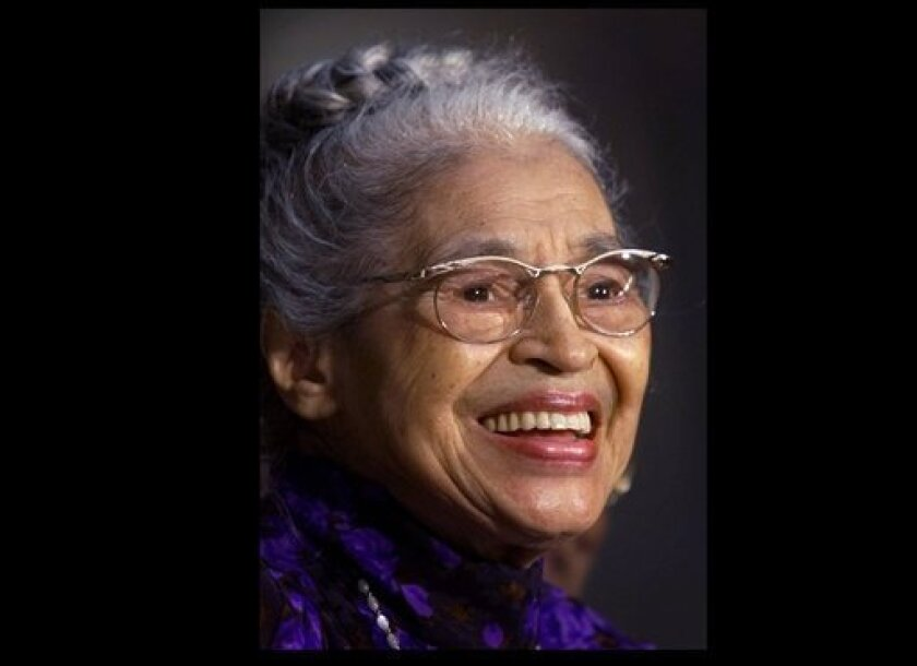 FILE -- In a June 15, 1999 file photo Rosa Parks smiles during a Capitol Hill ceremony where  Parks was honored with the Congressional Gold Medal in Washington.   Parks will become the first black woman to be honored with a full-length statue in the Capitol's Statuary Hall on Wednesday Feb. 27, 201