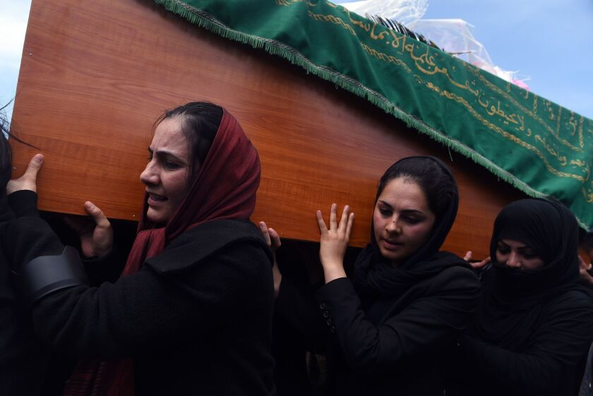 Burial of wrongly accused Afghan woman