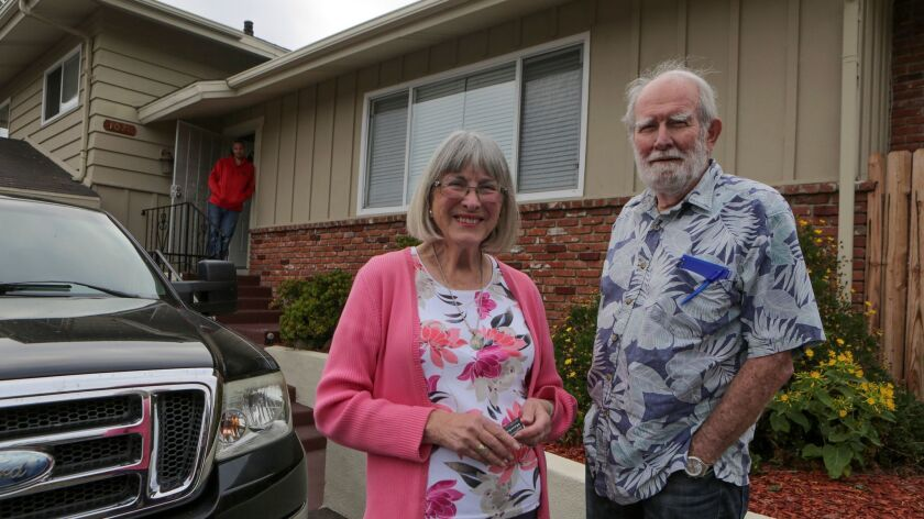 Encinitas residents Joyce and Harley Noel in front of their nonprofit Hawkes Home, a house in Vista that provides low-cost sober living space to men leaving prison.