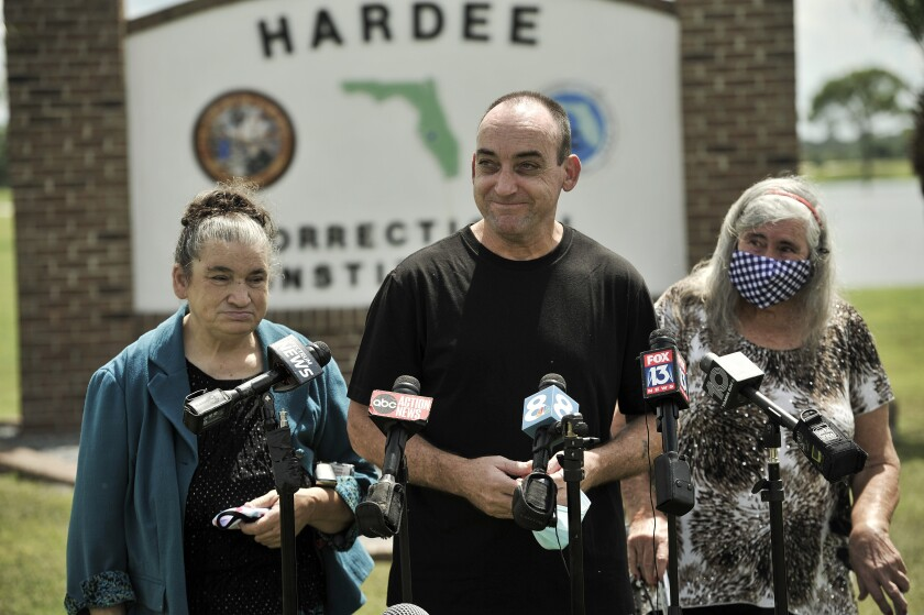 FILE - In this Aug. 27 2020 file photo, former inmate Robert DuBoise, 56, meets reporters with his sister Harriet, left, and mother Myra, right, outside the Hardee County Correctional Institute after serving 37 years in prison, when officials discovered new evidence that proved his innocence in Hardee County, Fla. DuBoise, exonerated of a 1983 rape and murder after serving 37 years in prison is suing over his wrongful conviction in which a a questionable bite mark was critical evidence. (AP Photo/Steve Nesius, File)