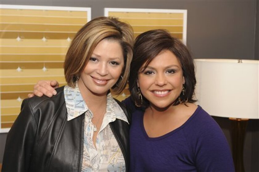 This undated photo provided by The Rachael Ray Show shows Rachael Ray, right, and Daisy Martinez in New York, Wednesday, Nov. 5, 2008. Rachael Ray is giving Food Network fans a taste of the Latino kitchen. Ray is producing a new show for the network starring actress and cookbook author Daisy M