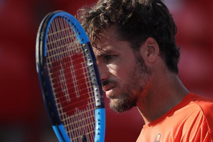 El tenista español Feliciano López reacciona ante el estadounidense Jared Donaldson hoy, jueves 1 de marzo de 2018, durante un partido correspondiente a los cuartos de final del Abierto Mexicano de tenis que se disputa en Acapulco (México). EFE