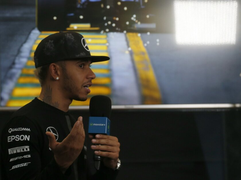 Mercedes driver Lewis Hamilton of Britain speaks during an interview in his hospitality suite at the Suzuka Circuit ahead of the Japanese Formula One Grand Prix in Suzuka, Thursday, Sept. 24, 2015. (AP Photo/Toru Takahashi)