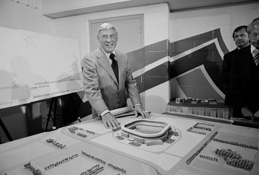 Former Los Angeles Rams owner Carroll Rosenbloom poses with a model of Anaheim Stadium in July 1978.