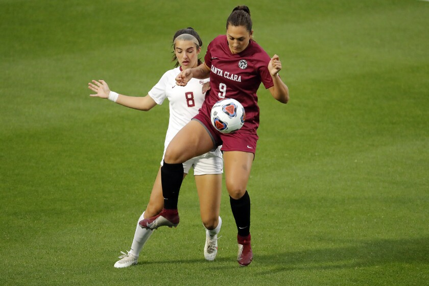 Santa Clara midfielder Izzy D'Aquila (9) controls the ball in front of Florida State forward Lauren Flynn (8) during the first half of the NCAA College Cup championship soccer match in Cary, N.C., Monday, May 17, 2021. (AP Photo/Karl B DeBlaker)