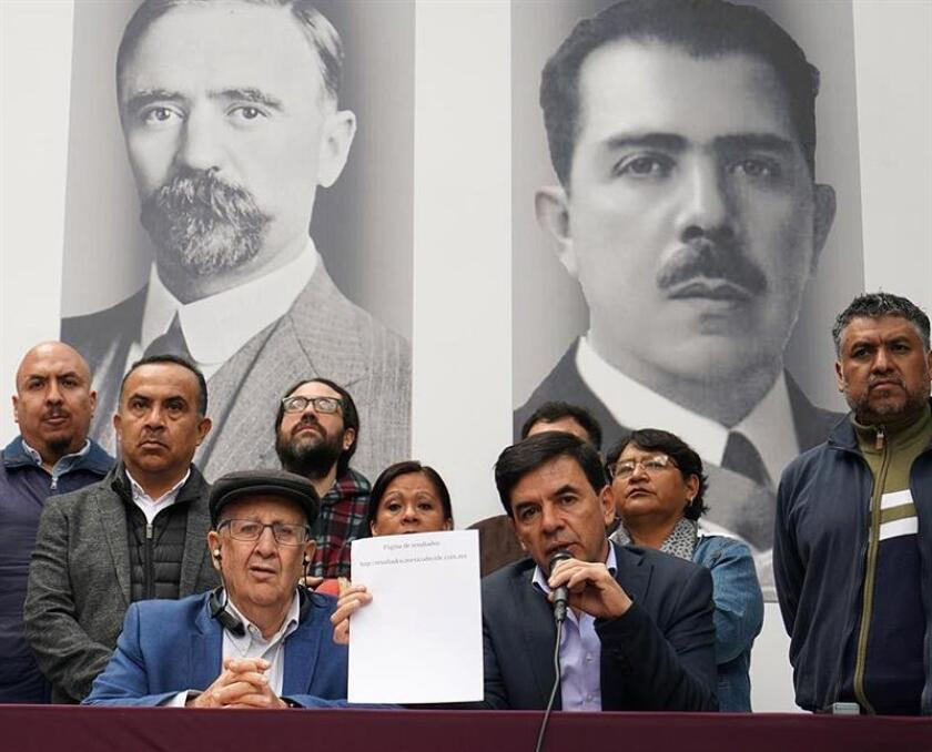 "Mexico City, Mexico, Nov. 26, 2018: Courtesy image from the communications office of Andres Manuel Lopez Obrador (AMLO). ""We are all learning from these exercises: citizens, organizations and the media. And the trustworthiness of the referendum has been clear, in terms of citizen acceptance and improvement of procedures,"" future presidential spokesman Jesus Ramirez Cuevas (R) told a press conference. EPA/EFE/AMLO COMMUNICATIONS OFFICE/"