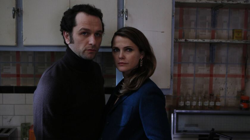 "THE AMERICANS -- ""Munchkins"" Episode 410 (Airs, Wednesday, May 18, 10:00 pm/ep) --(L-R) - Matthew Rh"