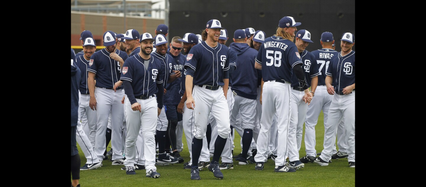 Padres pitchers and catchers share a laugh together on the first official day of Padres spring training for pitchers and catchers.