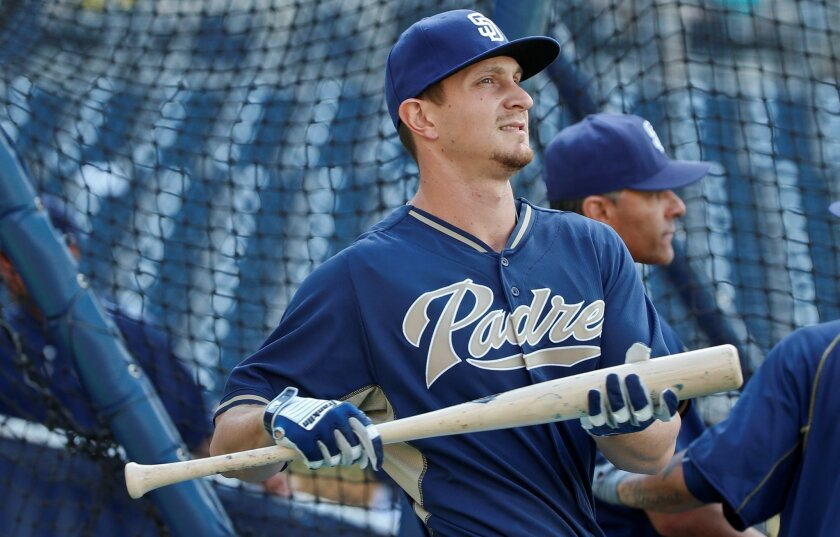 Padres left fielder Alex Dickerson gets loose for batting practice prior to a baseball game against the Texas Rangers Wednesday, Sept. 2, 2015, in San Diego.