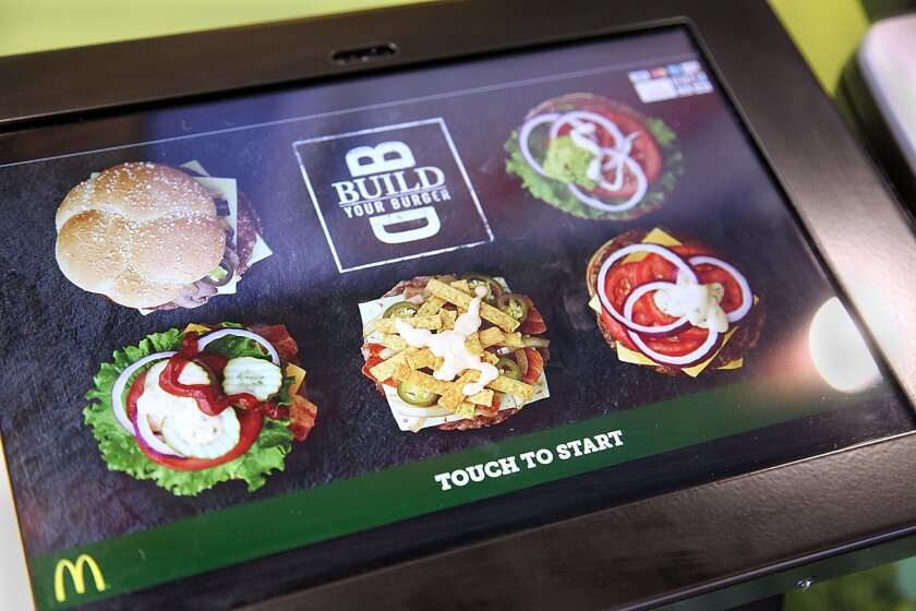 The McDonald's restaurant on Midway Drive in Sports Arena is featuring a new concept called Build Your Burger that will have customers order on a computer then wait for their food to be delivered tableside, the way they like it. Customers can build their own burgers via touch screen computers that