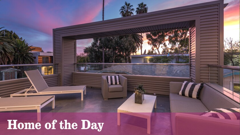 A rooftop deck takes in the sunset from the Venice home.