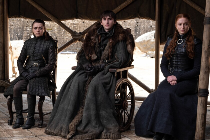 """Arya, Bran and Sansa Stark in the finale of 'Game of Thrones,' """"The Iron Throne,"""" on Sunday. (Helen"""
