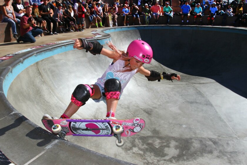 Bella Kenworthy, 8, of Dana Point, competes in the under-14 division of the bowl competition Saturday during the Exposure female skateboarding event at Encinitas Community Park.