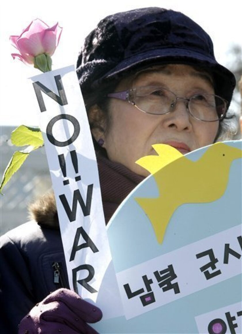 A South Korean anti-war protester participates during a rally against South Korean activists who launch propaganda leaflets toward North Korea,  at a main gate of Defense Ministry in Seoul, South Korea, Wednesday, March 2, 2011. South Korean activists say they will continue the protest despite Pyon