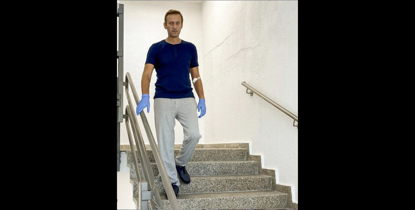 In this photo taken from a video published by Russian opposition leader Alexei Navalny on his instagram account, Russian opposition leader Alexei Navalny walks down stairs in a hospital in Berlin, Germany, Saturday, Sept. 19, 2020. Navalny, who is being treated in a German hospital for suspected poisoning by a nerve agent, says on social media that he is recovering verbal and physical abilities despite despairing at first. (Navalny Instagram via AP)