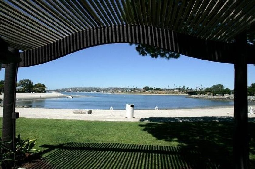 The front porch of one of the 462 previously renovated bungalow-style guest rooms at Paradise Point Resort opens to an inviting view of Mission Bay.