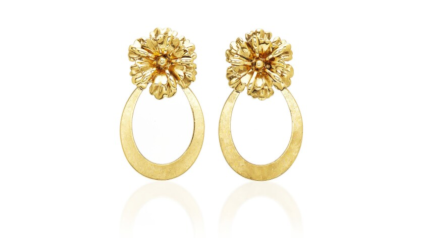 Aretha Franklin's use of bold statement earrings is iconic. Jennifer Behr's gold-tone floral pos