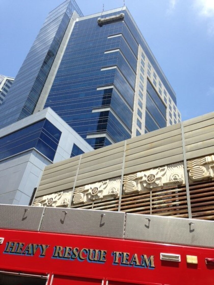 Fire crews were called to rescue two window washers stuck in their rig, 21 floors above ground, in downtown San Diego on Monday afternoon.