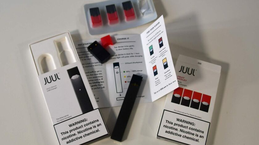 The contents of a Juul e-cigarette box, with the device and cartridges.
